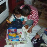 "Roma chid opening his Christmas ""shoe box"" gift package."