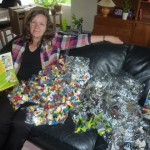 Anna displaying the contents of one of the Lego boxes
